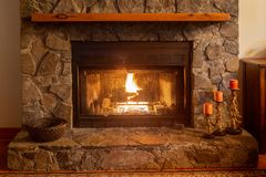 A warm fireplace in a mountain cabin in North Carolina. royalty free stock images