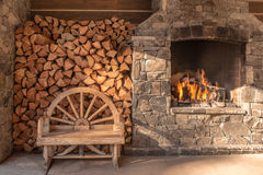 Warm fireplace outside a hotel lobby Royalty Free Stock Image