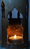 Warm flames in our candle Stock Images