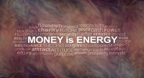 Money IS energy Word Cloud. A warm flowing energy formation background with a MONEY IS ENERGY word cloud Stock Photo