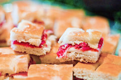 Warm focaccia with ham and scamorza cheese. Spare warm focaccia stuffed with ham and smoked cheese Stock Photography
