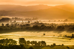 Warm foggy morning in the valley, Tuscany Stock Photography
