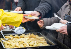 Warm food for the poor and homeless.  Royalty Free Stock Photography
