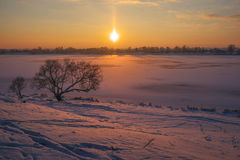 Warm freeze evening. Warm freeze or frozen sun. Landscape at the river's bank royalty free stock image