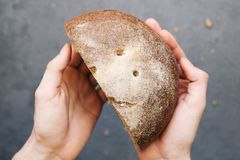 Warm, freshly rye bread. Cut the slices. Tear off a piece. top view. Farm food made from flour and eggs. Warm, freshly rye bread. Cut the slices. Tear off a Stock Photo