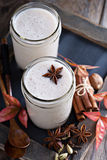 Warm frothy milk with spices. Warm frothy milk with syrup and winter spices Royalty Free Stock Photos