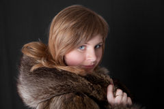 In a warm fur coat Stock Photo