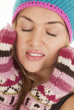 Warm gloves hat eyes closed Stock Photo