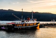 Ship in harbour of Port Alberni illuminated by late afternoon sun Royalty Free Stock Photo