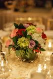 Flower table centerpience. A warm glow for table centerpiece Royalty Free Stock Photography