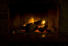 Warm glowing fireplace Stock Photography