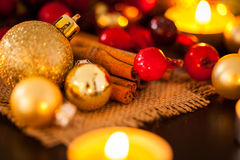 Warm gold and red Christmas candlelight background Stock Photo