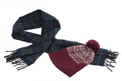 Warm greenish-blue wool scarf and red cap with winter pattern an Royalty Free Stock Image