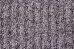 Warm grey Knitted Items with Braids and Pattern royalty free stock images