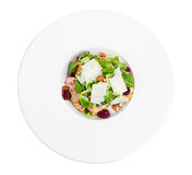 Warm grilled chicken salad with parmesan. Warm grilled chicken salad with parmesan and fresh corn salad. Isolated on a white background Royalty Free Stock Photos