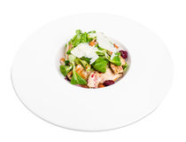 Warm grilled chicken salad with parmesan. Warm grilled chicken salad with parmesan and fresh corn salad. Isolated on a white background Stock Photo