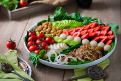 Warm grilled chicken salad with vegetables and fruits. Warm grilled chicken salad with strawberries, melon balls, onion rings, tomatoes, mangold, peas, white Stock Photography
