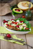 Warm grilled chicken salad with vegetables and fruits Stock Images