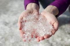 Beautiful ice crystals in women`s hands stock image