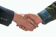 Warm handshake Stock Images