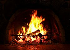 Warm Hearth in dark. Fireplace. Warm Hearth in dark stock image