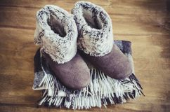 Warm home clothes. Woolen plaid and home slippers. Stock Image