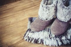 Warm home clothes. Woolen plaid and home slippers. Royalty Free Stock Images