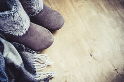 Warm home clothes. Woolen plaid and home slippers. Stock Images