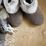 Warm home clothes. Woolen plaid and home slippers. Stock Photography