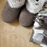 Warm home clothes. Woolen plaid and home slippers. Royalty Free Stock Photo