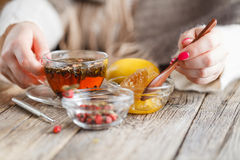 Warm honey tea with herbs Royalty Free Stock Photography