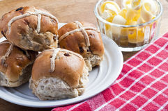 Warm hot cross buns with butter Royalty Free Stock Images