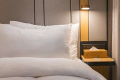 Warm Hotel Bedside and pillows royalty free stock photos