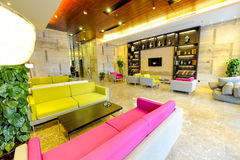 Warm hotel lobby. To a group of red and yellow sofa-based hotel lobby Stock Photography
