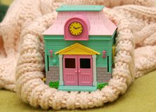 Warm house. A toy house inside warm suit Royalty Free Stock Photos