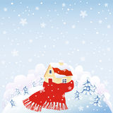 Warm house. Cute house wrapped in red warm scarf on snowing hill Royalty Free Stock Photos