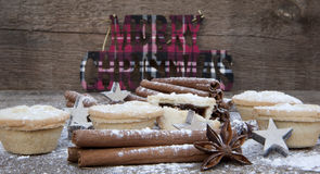 Warm image of Christmas foods on rustic style wooden background Stock Photos