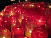 Warm and inviting red prayer candles inside the Sacré-Cœur, Paris royalty free stock image