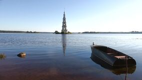 Warm July morning on the Uglich reservoir. View of the flooded bell tower. Kalyazin, Russia. Warm July morning on the Uglich reservoir. View of the flooded bell stock video footage