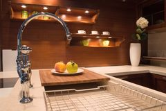 Warm Kitchen. A luxury kitchen. Night scene Stock Photo