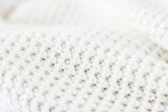 Warm knitted clothes, soft and white. Knitwear, fabric textures and handmade items concept - Warm knitted clothes, soft and white stock images