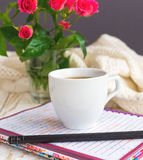 Warm knitted plaid, coffee, notebook and pensil Stock Photography