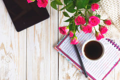 Warm knitted plaid,  coffee, notebook, pensil and tablet Royalty Free Stock Photos