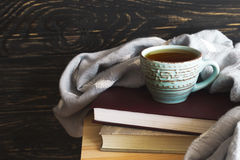 Warm knitted plaid, cup of tea and books Royalty Free Stock Photos