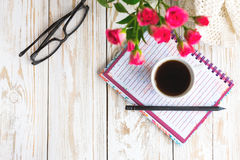 Warm knitted plaid, glasses, coffee, notebook and pensil Royalty Free Stock Photos