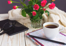 Warm knitted plaid, glasses, coffee, notebook, pensil and tablet Royalty Free Stock Photography