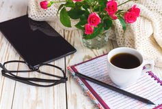 Warm knitted plaid, glasses, coffee, notebook, pensil and tablet Stock Photo