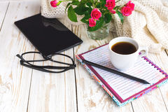 Warm knitted plaid, glasses, coffee, notebook, pensil and tablet Stock Images