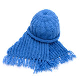 Warm knitted scarf and cap. Isolated on white Royalty Free Stock Photography