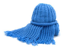 Warm knitted scarf and cap. Isolated on white Stock Photo